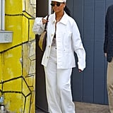 Rihanna wore white head to toe when visiting an art studio in 2018. The style icon debuted her Savage x Fenty lingerie line as a lacy bodysuit peeked out from under an all-denim look.