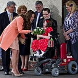 She received flowers from hospice patient Sally Evans during a visit to Winchester's Naomi House in April 2013.