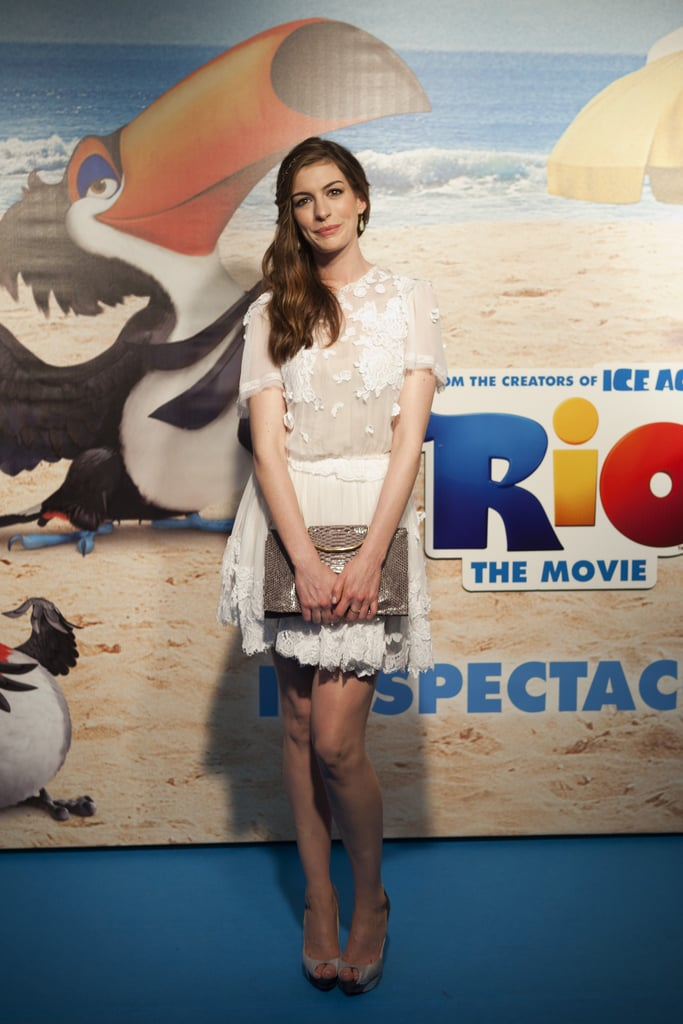"""Anne Hathaway was on trend in a lacy white Dolce & Gabbana dress to pose for photos in Rio de Janeiro yesterday at the premiere of Rio. She and her costar Jesse Eisenberg joined Jamie Foxx and will.i.am, who both contributed to the soundtrack, to promote the animated movie this week after first showing it off in LA in January. The actress went casual earlier in the day to join the group for a press conference, with Anne sharing that she loves """"the message that you can learn how to spread your wings and fly."""" Anne managed to fit a fun shopping trip with her boyfriend, Adam Shulman, in between her work obligations, and the couple checked out a few tourist locations around the city. Jamie appears to also be enjoying his time in South America too, jokingly tweeting that he's canceling his life and not leaving Brazil.  AP, Photos courtesy of Fox"""