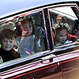 The pageboys and bridesmaids waved from their car.