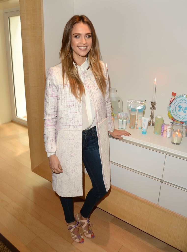 Jessica Alba worked a Spring coat with a silky blouse, skinny denim, and pastel lace-up sandals at the launch of her book, The Honest Life, in LA.