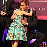 Harry hugged a young girl at the WellChild Awards at London's Intercontinental Hotel in 2012.
