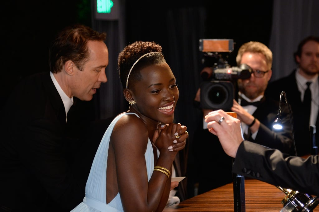 Lupita smiled while checking over her name.
