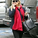 Reese Witherspoon carried holiday decorations in her purse.