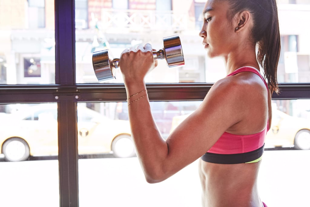 Get Strong For Your Next Holiday Party With This Full-Body Dumbbell Workout