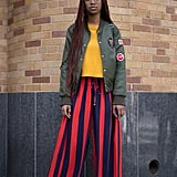 """Bomber jackets are the perfect sporty piece to layer with if you're not a """"girly girl."""" Wear with jeans or trousers."""
