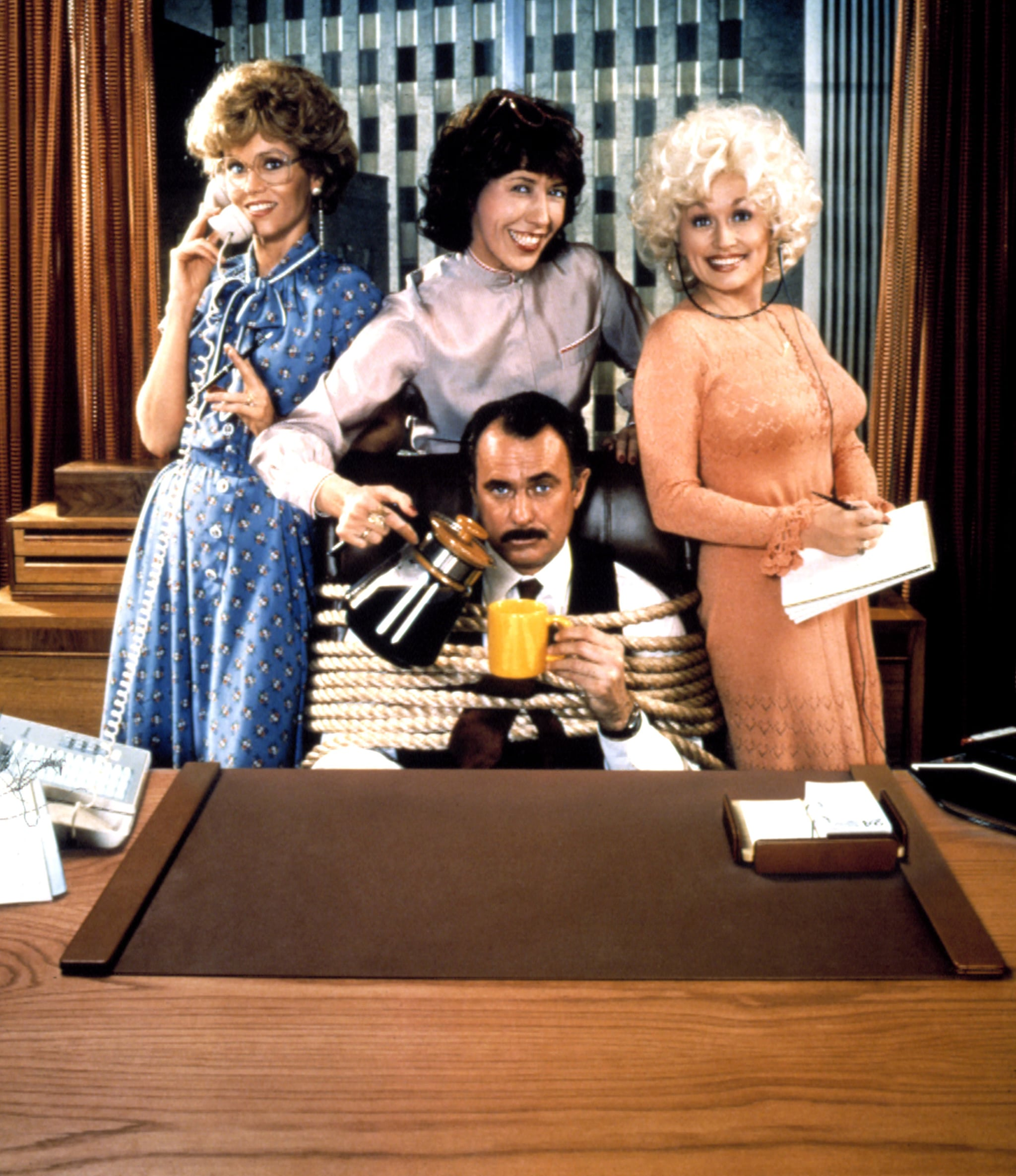 NINE TO FIVE, (aka 9 TO 5), Jane Fonda, Lily Tomlin, Dolly Parton, Dabney Coleman (seated), 1980, TM and Copyright (c)20th Century Fox Film Corp. All rights reserved.