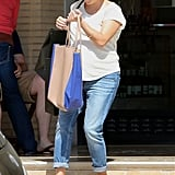 Reese Witherspoon showed off her baby bump while shopping in LA.