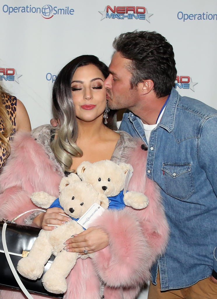 Lady Gaga and her handsome fiancé, Taylor Kinney, aren't afraid of a little red carpet PDA. Over the years, the cute couple has shared more than a few sweet moments together, regularly showing their love for each other when they attend events. Most recently, Taylor showed his support for Lady Gaga at Saturday's American Horror Story premiere, adding to their long list of cute moments together. Taylor proposed to the singer this past February, and since then, he's shared some details on the proposal, while Lady Gaga has opened up about her wedding dress. Keep reading to check out their best PDA pictures ever!