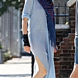 Anne Hathaway put on a long, blue shirtdress in NYC.
