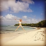 """Poppy Delevingne gave us our weekly """"jumping in the air in a tiny bikini"""" social snap during her recent beach vacation. Source: Instagram user poppydelevingne"""