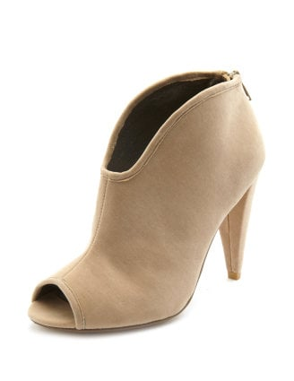 The shape of the nude-toned bootie is super sexy and modern — and provides an effortless way to dress up a jeans-and-tee outfit. Charlotte Russe sculpted velvet bootie ($33)