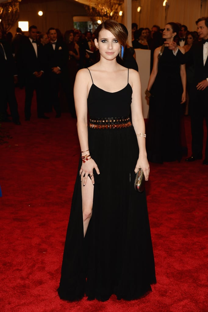Emma Roberts showed a little leg in a black Diane von Furstenberg gown, which was cinched with a beaded belt. She finished the look with Walter Steiger claw heels and a Baccarat bracelet.