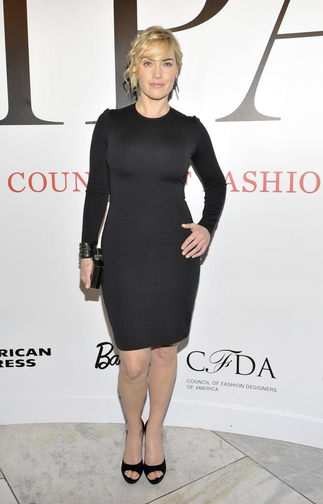 Kate Winslet in a black St. John dress.