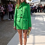 Olivia sat front row at Valentino in a streamlined kelly-green set.