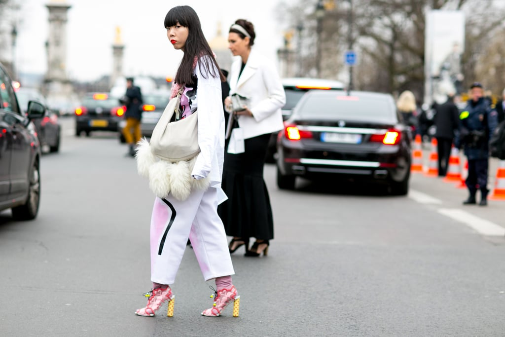 We can't decide what we love more — Susie Bubble's heels or her bag. She knows her way around some all-star accessories.