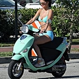 Selena Gomez looked like a pro on her bright scooter.