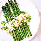 Asparagus spears with mustard yoghurt make for the perfect healthy side dish. Source: Instagram user brownpapernutrition