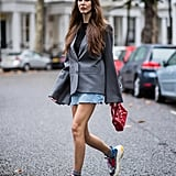 Wear Dad Trainers With a Sophisticated Blazer and Denim Miniskirt