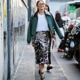 In Milan, Olivia slipped into sequins and texture for a look that wowed us all.