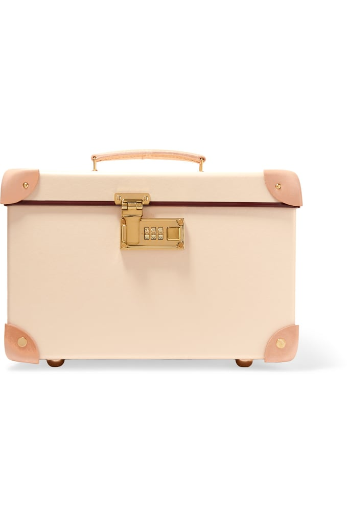 You can't go wrong toting your things in the same heritage brand luggage that Queen Elizabeth II relies on, right? Especially since this Globe-Trotter Safari Leather-Trimmed Fiberboard Vanity Case ($1,140) is lighter than aluminum but more durable than leather.