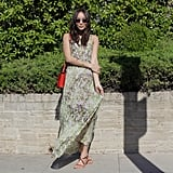 Ashley Madekwe showed off a perfect-for-Spring maxi, which she complemented with her bag's bold pop of cherry red. Source: Ring My Bell