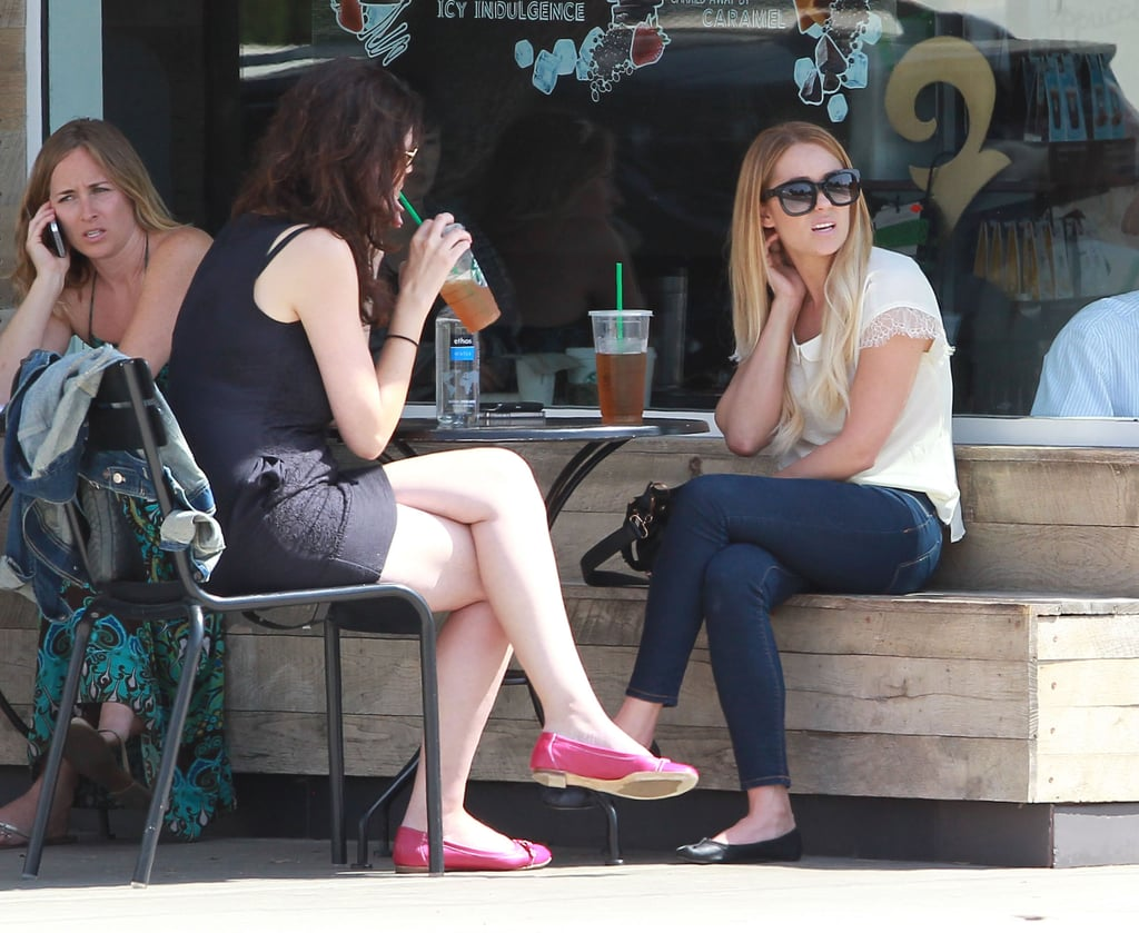 Lauren Conrad and hung out at a table outside at Starbucks in LA.