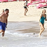 Liev Schreiber gave son Sasha a piggyback with Naomi Watts on the beach.