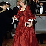 Despite being pregnant with William at the time, Princess Diana wasn't one to shy away from major social events. Here she is at the Barbican Centre in March 1982 dressed in a red maternity gown by David Sassoon.