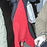 Kate Wore Her Red Alexander McQueen Dress Under a Long Black Coat