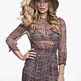 Channeling her signature boho vibes in a printed minidress and feather-trimmed hat.
