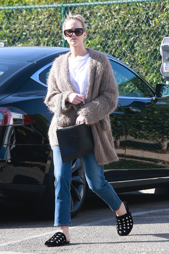 Sometimes we wish we could leave the house in our slippers, and Jennifer Lawrence just did that, kind of. The actress went shopping in LA and dressed down in a comfy white cropped t-shirt and blue jeans. She added texture to her outfit with a brown fuzzy cardigan and a chain-link bag.  When we finally got down to her shoes, that's when we noticed it: her mules resembled house slippers! The Alexander Wang footwear ($650) featured studs all over, and the furry lining gave Jennifer's feet extra cushion. Though, we admit, the slippers are definitely cuter than the ones we wear at home. Read on to see Jennifer's shopping shoe of choice, then pick up her exact pair or a similar option.      Related:                                                                                                           For a Funny Girl, Jennifer Lawrence Has Had Some Seriously Stunning Red Carpet Moments