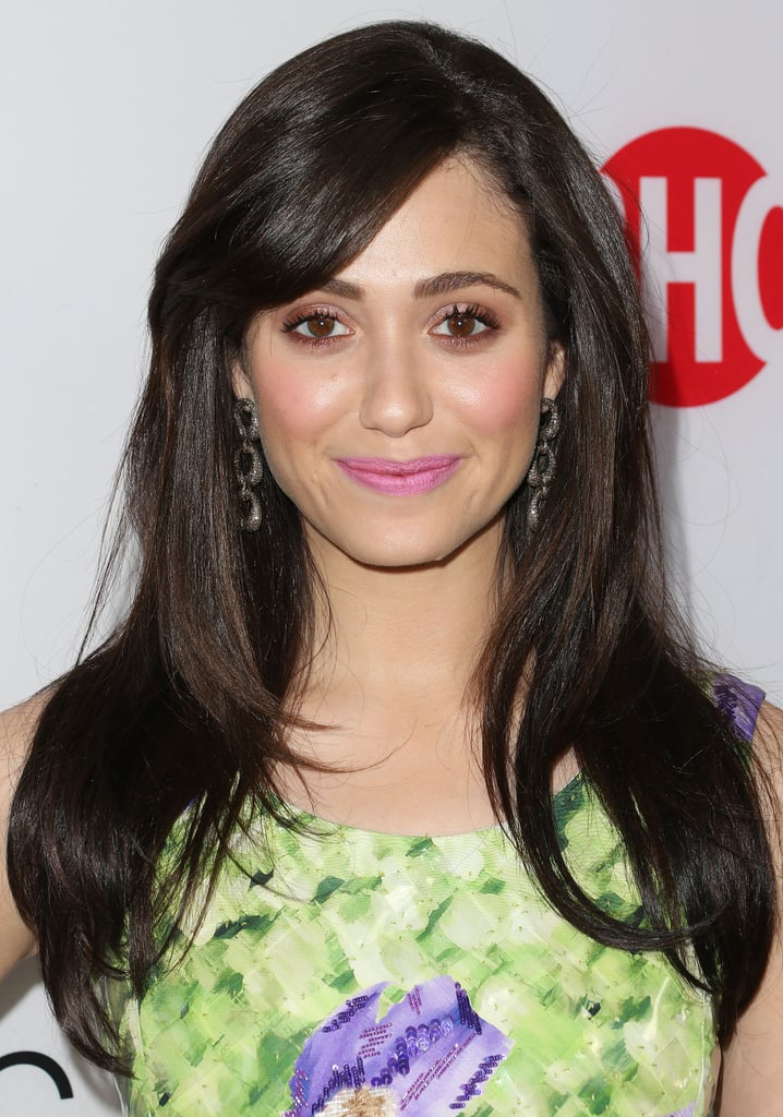 Emmy Rossum wore a pink makeup look for her appearance at an event for Showtime's Shameless, which she coupled with a shiny, voluminous blowout.