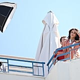 Eva Longoria looked off of the rooftop of a hotel for a photo shoot at the Cannes Film Festival.