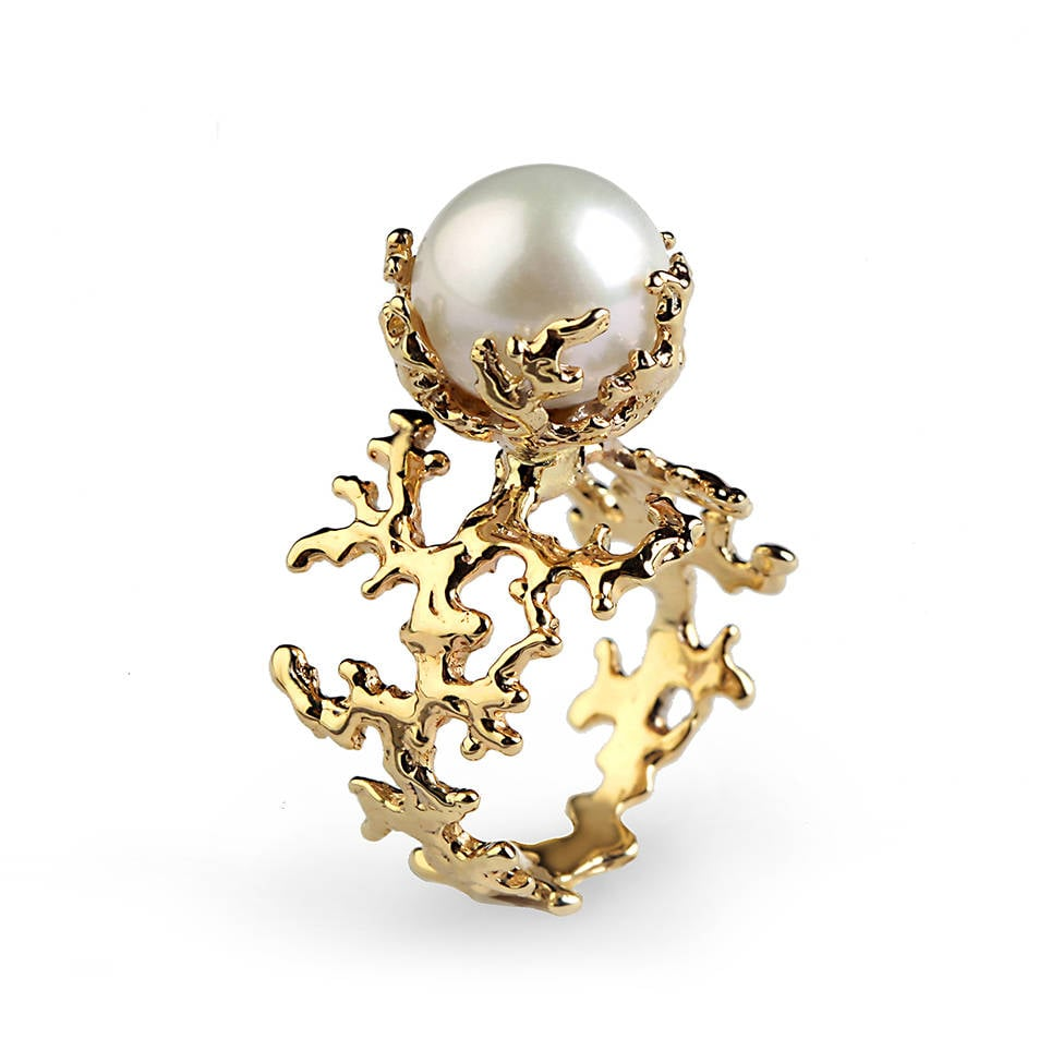 This ring's band was inspired by the living sculptures of coral ($1,210) and features a round white pearl.