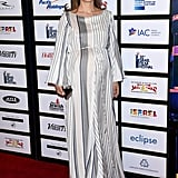 For the 30th Israel Film Festival Anniversary Gala Awards Dinner, the star chose a silky striped dress with sleeves and wore a pair of simple hoop earrings.