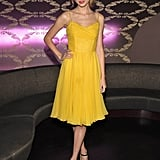 Taylor Swift's yellow chiffon frock is a bit retro, a lot sweet. The bow sandals add a hint of whimsy.
