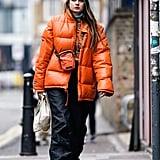 Style an Orange Puffer With Nylon Pants and White Kicks