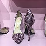 "While the pop-up's piece de resistance — the Better Than Sex Stilettos ($225) — speak for themselves, Jerrod kindly gave us the backstory on how the sky-high heels came to be.  ""I was working with Erika Jayne, and we came up with this Cinderella-esque story,"" Jerrod recalled. ""I played a fairy godfather janitor, and we needed a shoe."" Over the course of a year, the duo worked with the Italian company Mink Shoes to produce the vegan glitter heels. While the toe and heels of the stiletto are covered in millennial pink glitter, the sides are see-through — that's a nod to the ""glass slipper"" inspiration. To finish things off, two lashes adorn the back of the shoe. (""So you can wink as you're leaving,"" Jerrod explains.) Jerrod stressed that the heels are available only in ""super limited quantities,"" but if you're fast enough, you can actually purchase these bad boys from the comfort of your couch. Starting on Oct. 18, you can cop the Better Than Sex Stilettos ($225) on the Too Faced website."