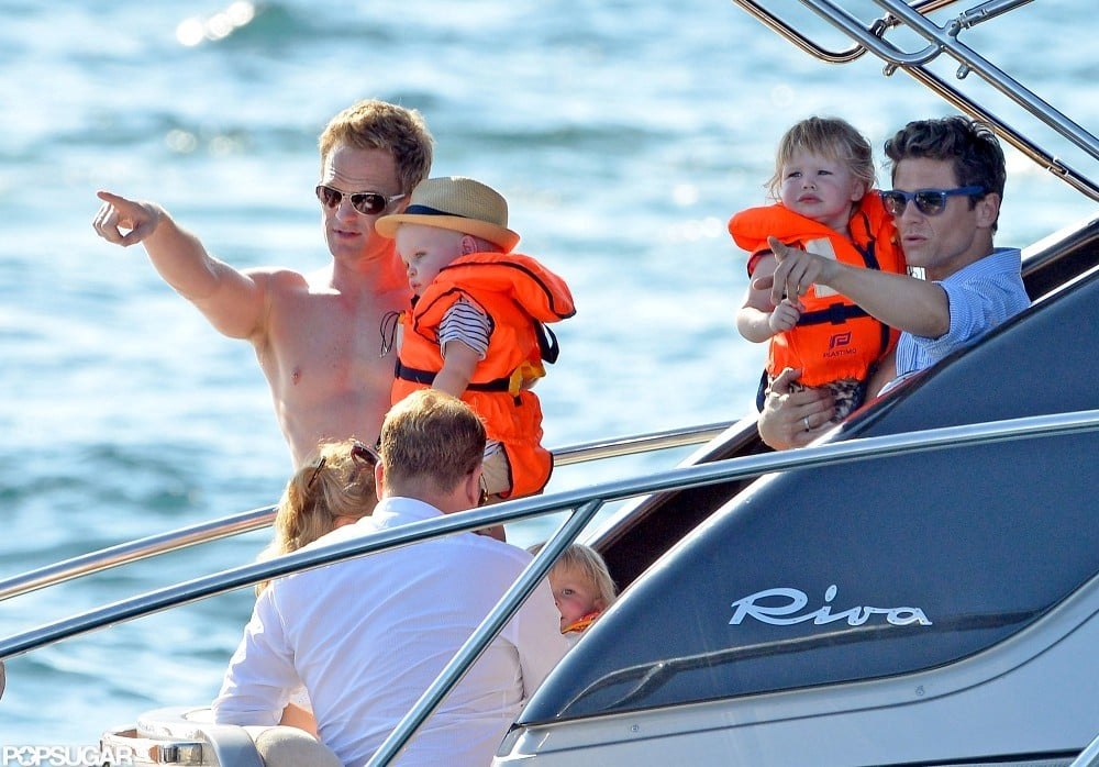Neil Patrick Harris and his partner, David Burtka, suited up their twins in life jackets yesterday and joined Elton John and his family for a day of yachting in Saint-Tropez. Elton's partner, David Furnish, and their son, Zachary John-Furnish, relaxed in the sun while Neil and David showed Gideon and Harper the view.  The families kicked off their European getaway on Wednesday at Le Club 55 before hitting the beach and taking a motorboat ride. The vacation seems to be becoming a tradition for the friends who made a similar trip to the South of France last August. The couples' kids are close in age with Gideon and Harper turning 2 in October and Zachary following closely behind in December.