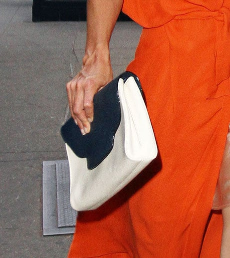 A close-up of the classic navy and white clutch.