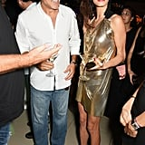 Amal finished her statement look with pointed-toe patent leather heels.