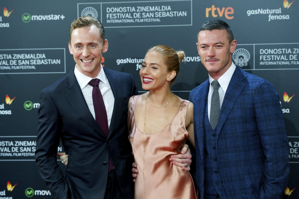 Sienna Miller was accompanied by her two sexy costars, Luke Evans and Tom Hiddleston, for the Tuesday premiere of High Rise at the San Sebastian International Film Festival in Spain. The trio stunned on the red carpet, but the real highlight of the night was their cute interactions. Earlier in the day, the group attended a photocall for the film, where Sienna chose a checked Victoria Beckham dress straight from the New York Fashion Week runway. While Sienna didn't make it to NYC for the fashion fun, she did attend Monday's Burberry show during London Fashion Week. Keep reading to see more photos from the group's fun red carpet outing, then see what Luke recently told us about Emma Watson.