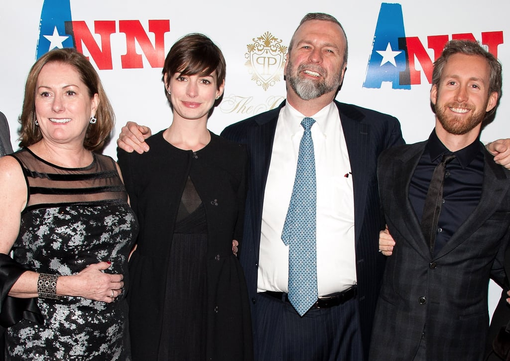 Anne Hathaway and Adam Shulman joined Anne's parents, Gerald Hathaway and Kate McCauley Hathaway, and her two brothers, Michael and Thomas Hathaway, last night at the premiere of Ann in NYC. Kate produced the new one-woman show, which stars Holland Taylor as late Texas politician Ann Richards. The family posed for pictures before the opening performance at the Vivian Beaumont Theater.  Anne has been keeping a relatively low profile since winning best supporting actress at the Oscars late last month. She and Adam extended their stay in LA for a couple of weeks after award season wrapped up but returned home to Brooklyn a few days ago in time to toast her mother's new play.