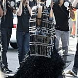 Kim Kardashian wore a high fashion garment as photographers snapped photos.