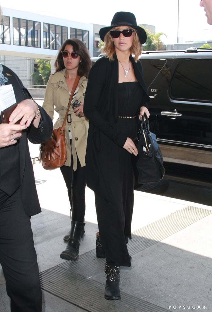 """Jennifer Lawrence wore an all-black ensemble to catch a flight out of LAX yesterday. She was reportedly headed to Montreal to begin filming for her latest project, X-Men: Days of Future Past. Jennifer's on the go again after taking a trip last week to NYC, where she donned a Dior gown to make her debut trip up the stairs at the Met Gala. Also in attendance at the fashionable event was her ex-boyfriend Nicholas Hoult, who was joined by his rumored new girlfriend, Riley Keough. There was no drama between Jennifer and Nicholas, though, since he shared on the red carpet that they are """"friends."""" It looks like their new relationship status will help them professionally as well since they'll soon reunite on the set of the latest X-Men installment."""