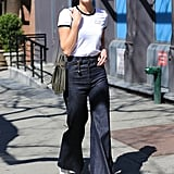Your go-to might be to tuck a shirt into skinny jeans, but Karlie Kloss proves a flared option works just as well for Spring.