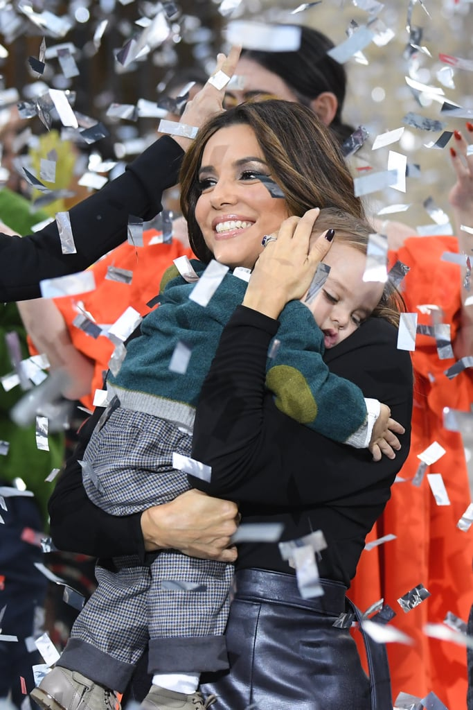 "Eva Longoria's 1-year-old old son, Santiago Enrique Bastón, made his Paris Fashion Week debut on Sept. 28, and he looked adorable doing it. The cute mother-son duo stepped onto the runway at the Le Defile L'Oreal Paris show, along with celebrities like Andie MacDowell, Camila Cabello, Amber Heard, Helen Mirren, and more.  Eva cradled Santiago in her arms as confetti fell around them, and although he looked a little shy, he still got a lot of love from the models onstage. Can you blame them? One look at his ""B"" sweater, and we're all smitten too. Eva and her husband José Bastón welcomed their first child back in June 2018, and he's been delivering cute moments ever since. Keep reading to see more of the sweet runway photos!"