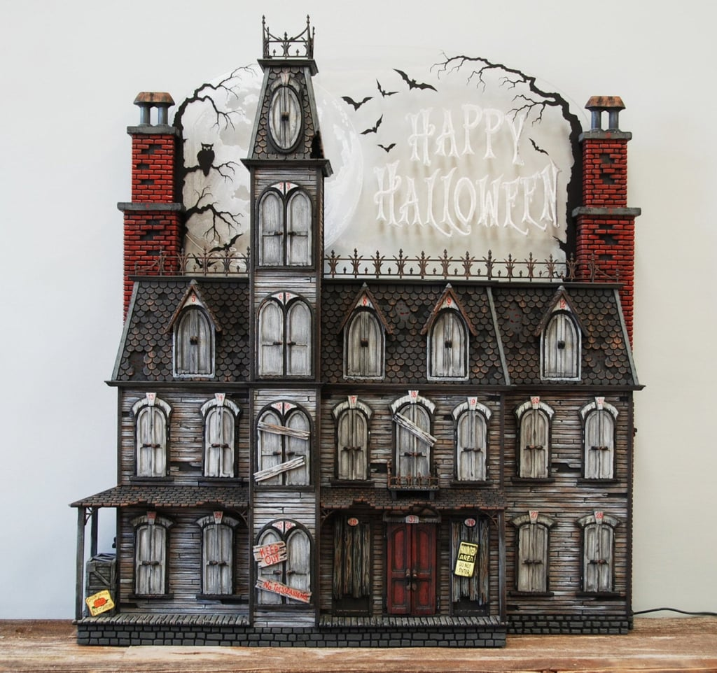 "Currently at the top of my list of ""Things I Never Knew I Needed Until Today"" is this hauntingly gorgeous Halloween Advent calendar made to look just like a creepy Victorian mansion — consider me officially spooked! Available on Etsy for a casual $1,465, the beautifully handcrafted Halloween decoration looks like the perfect centerpiece for a chilling Halloween extravaganza. I can already picture the zombiefied lords and ladies that lurk behind the house's shutters.  No two houses are exactly alike, but each mansion is approximately 37 inches tall and 34 inches wide and weighs about 26 pounds. Behind the shutters of each window is an original piece of artwork — including zombies, skeletons, witches, trick or treaters, and more — just waiting to make your October a little more chilling. There's even a crate on the porch that can be customized with the word of your choice! From the ""No Trespassing"" signs strung up around the house's exterior to the ghostly chimney dwellers and the eyes appearing out of the broken rooftop, every inch of this calendar is designed to make for a happy Halloween. The entire mansion can also be plugged in, lighting up your home a little more each night as more shutters are opened. You can even customize the luminous background of the mansion, which features an ominous full moon, with the phrases ""Happy Halloween"" or ""Trick or Treat."" Despite its eerie details, this Advent calendar definitely looks like something the whole family can enjoy . . . and I might have to get my family to pitch in for this one given the price tag. Considering this is the kind of decoration that can be passed on as a family heirloom, though, it might just be worth it if you truly love Halloween. If you dare, take a closer look at the haunting Victorian Mansion ahead.       Related:                                                                                                           This 7-Foot Hairy Spider Lights Up — Good Grief, the Neighbors Are Gonna Hate You"