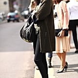 Tough-girl add-ons like a studded Alexander Wang Rocco bag and patent platform ankle boots gave this Fall ensemble trendier appeal. Source: Greg Kessler